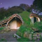 Wales, Dale Simon  http://greenbuildingelements.com/2008/12/01/hand-build-an-earth-sheltered-house-for-5000/